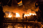 Antigovernment protesters guard the perimeter of Independence Square known as Maidan on February 19 2014 in Kiev Ukraine After several weeks of calm...