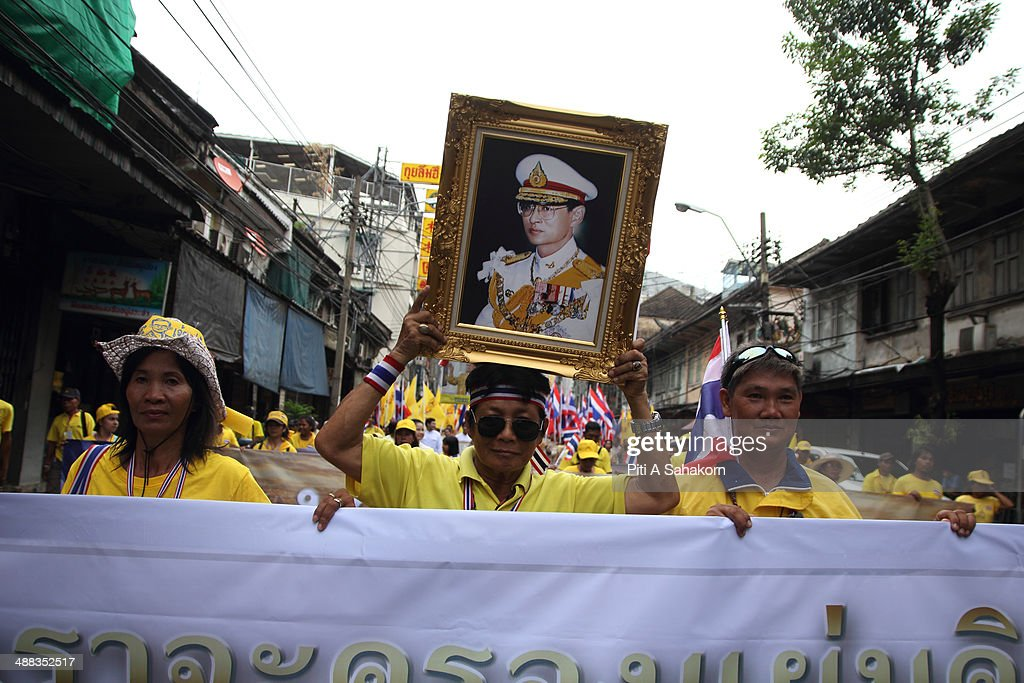 Anti-government protesters hold a portrait of King Bhumibol Adulyadej during a rally showing their loyalty to King Bhumibol Adulyadej on the 64th anniversary of his Coronation Day. Thailand's revered King Bhumibol Adulyadej made a rare public appearance to mark the 64th anniversary of his coronation. Thailand's Election Commission and the caretaker government agreed to hold new elections on 20 July 2014 after several months of political turmoil and uncertainty while anti-government protesters calling the resignation of caretaker Prime Minister Yingluck Shinawatra and demanding political reforms before any new elections.