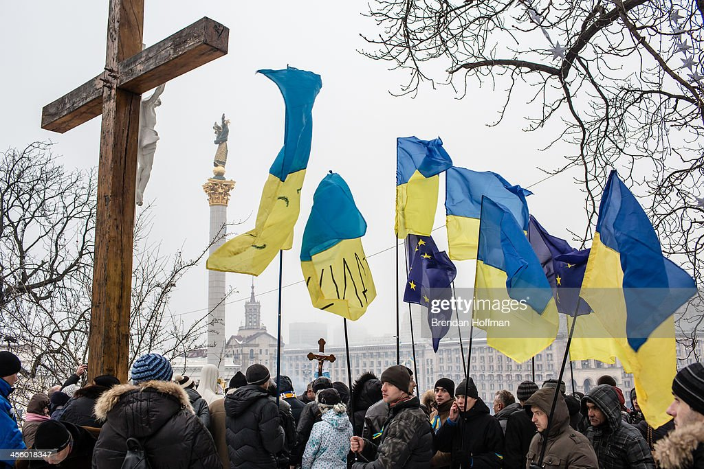 Anti-government protesters hold a religious service on a hill overlooking Independence Square on December 13, 2013 in Kiev, Ukraine. Thousands of people have been protesting against the government since a decision by Ukrainian president Viktor Yanukovych to suspend a trade and partnership agreement with the European Union in favor of incentives from Russia.