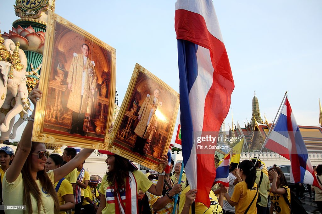 Anti-government protesters hold portraits of King Bhumibol Adulyadej during a rally showing their loyalty to King Bhumibol Adulyadej on the 64th anniversary of his Coronation Day. Thailand's revered King Bhumibol Adulyadej made a rare public appearance to mark the 64th anniversary of his coronation. Thailand's Election Commission and the caretaker government agreed to hold new elections on 20 July 2014 after several months of political turmoil and uncertainty while anti-government protesters calling the resignation of caretaker Prime Minister Yingluck Shinawatra and demanding political reforms before any new elections.