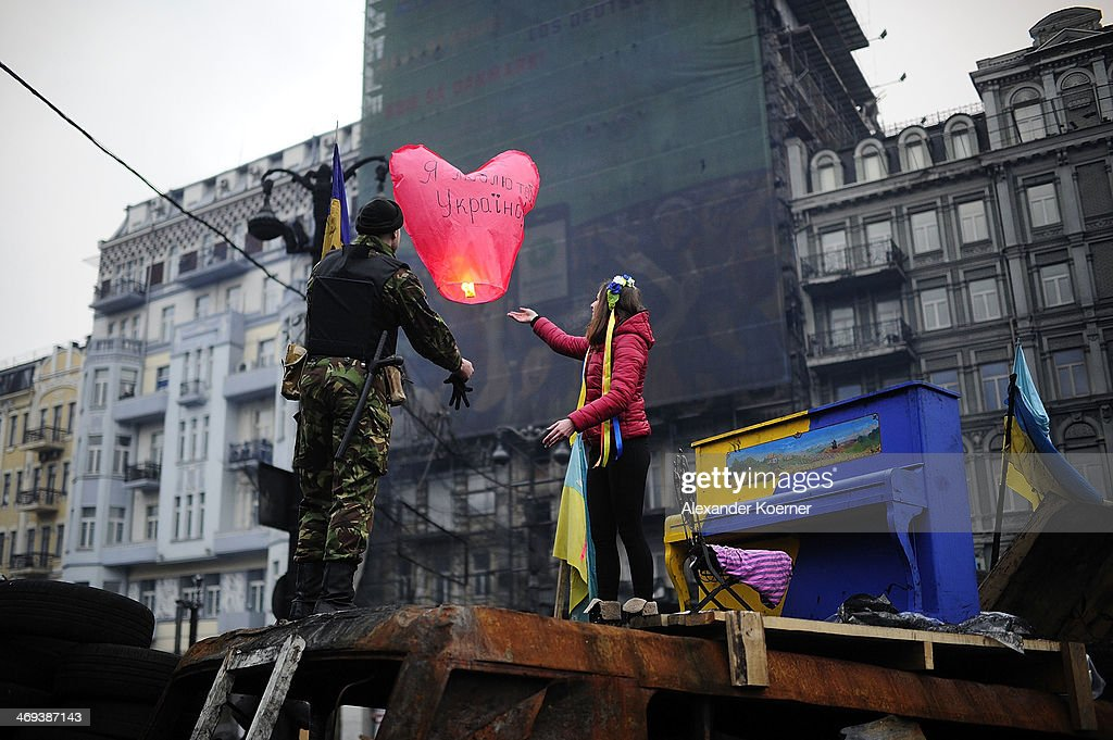 Anti-government protesters lighten up a sky lantern to promote a peaceful solutions for the future of the Ukraine inside a barricade on Grushevskogo Street on February 14, 2014, in Kiev, Ukraine. According to Opposition Officals, Berkut police forces could attack the barricades any moment; protesters have gathered inside and prepared fireworks and molotov-cocktails. Media and other people were removed from the barricades. Russian Foreign Minister Sergei Lavrov again issued a warning to the West against interfering in Ukraine's political crisis during today's joint press conference with German federal foreign Minister Walter Steinmeier, who is on a two-day visit to Russia. According to reports Ukrainian opposition leaders Vitaly Klitschko and Arseny Yatsenyuk are set to meet with German Chancellor Angela Merkel on February 18, 2014 in Germany.