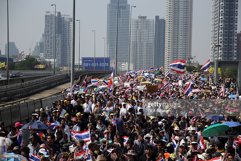 Anti-government protesters march across Taksin Bridge during a rally in Bangkok. More than one million anti-government protesters massed ahead of a major rally aimed at toppling the Prime Minister, paralysing parts of central Bangkok. The Election Commission (EC) has expressed concern over the mass anti-government rallies beginning today, fearing they could prevent the first day of election candidate registration on Monday. The Democrat Party said it would boycott February's general election, deepening a political crisis as protesters called for another major rally to step up efforts to oust the government and force political reforms.