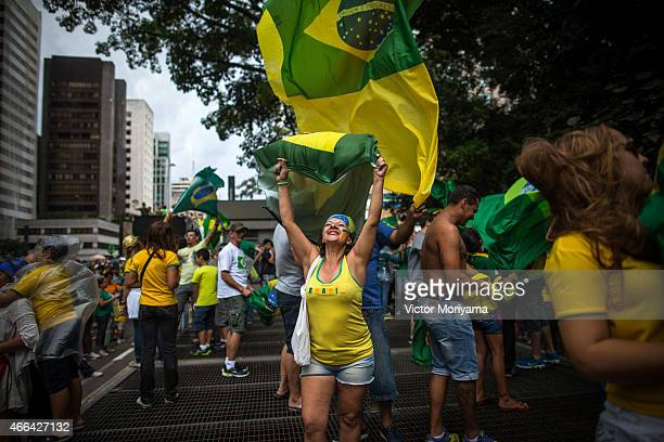 Antigovernment protesters march along Avenida Paulista on March 15 2015 in Sao Paulo Brazil Protests across the country were held today against...