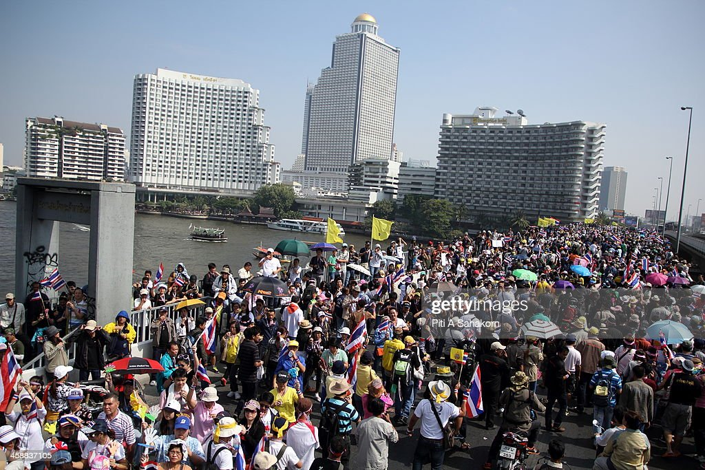 Anti-government protesters march cross Taksin Bridge during a rally in Bangkok. More than one million anti-government protesters massed ahead of a major rally aimed at toppling the Prime Minister, paralysing parts of central Bangkok. The Election Commission (EC) has expressed concern over the mass anti-government rallies beginning today, fearing they could prevent the first day of election candidate registration on Monday. The Democrat Party said it would boycott February's general election, deepening a political crisis as protesters called for another major rally to step up efforts to oust the government and force political reforms.