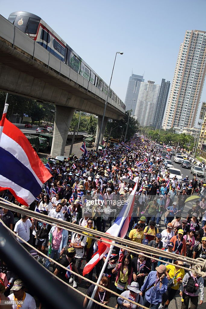 Anti-government protesters march near the BTS railway which crosses the Taksin Bridge during a rally in Bangkok. More than one million anti-government protesters massed ahead of a major rally aimed at toppling the Prime Minister, paralysing parts of central Bangkok. The Election Commission (EC) has expressed concern over the mass anti-government rallies beginning today, fearing they could prevent the first day of election candidate registration on Monday. The Democrat Party said it would boycott February's general election, deepening a political crisis as protesters called for another major rally to step up efforts to oust the government and force political reforms.