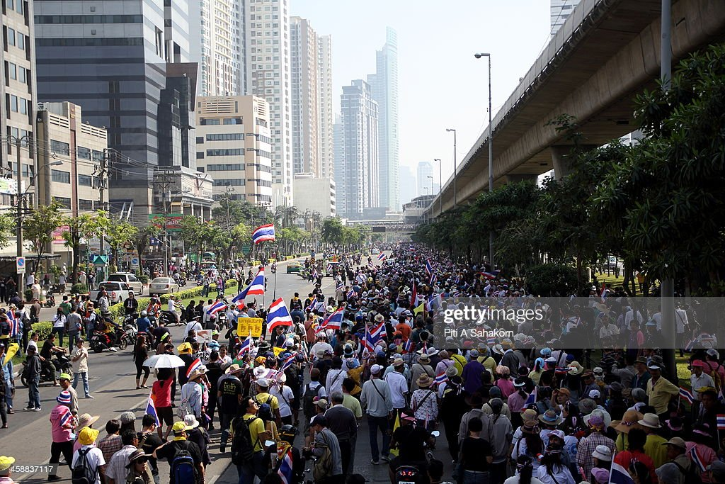 Anti-government protesters march on Taksin Road during a rally in Bangkok. More than one million anti-government protesters massed ahead of a major rally aimed at toppling the Prime Minister, paralysing parts of central Bangkok. The Election Commission (EC) has expressed concern over the mass anti-government rallies beginning today, fearing they could prevent the first day of election candidate registration on Monday. The Democrat Party said it would boycott February's general election, deepening a political crisis as protesters called for another major rally to step up efforts to oust the government and force political reforms.