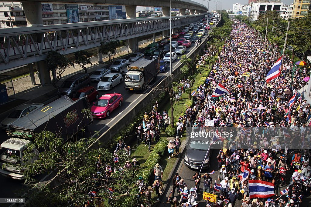 Anti-government protesters march on Taskin Road during a rally in Bangkok. More than one million anti-government protesters massed ahead of a major rally aimed at toppling the Prime Minister, paralysing parts of central Bangkok. The Election Commission (EC) has expressed concern over the mass anti-government rallies beginning today, fearing they could prevent the first day of election candidate registration on Monday. The Democrat Party said it would boycott February's general election, deepening a political crisis as protesters called for another major rally to step up efforts to oust the government and force political reforms.