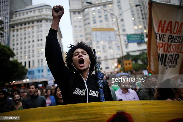 Antigovernment protesters march through the Centro district on October 31 2013 in Rio de Janeiro Brazil Protesters called for an end to police...