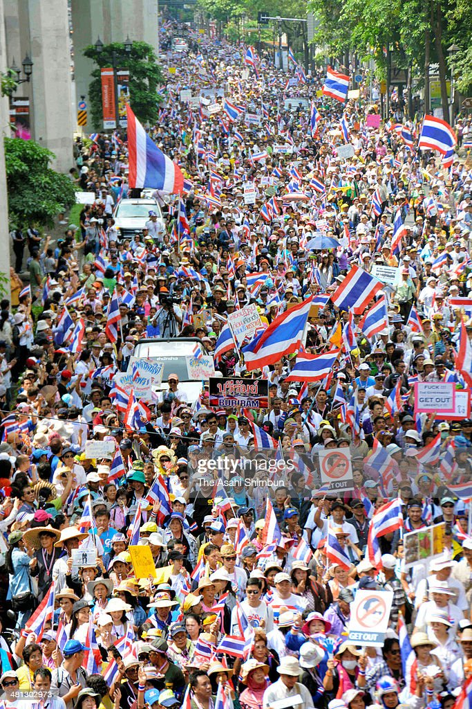 Anti-government protesters march through the city centre on March 29, 2014 in Bangkok, Thailand. Tens of thousands of anti-government protesters marched through the Thai capital in calling for political reform to take place before elections and the ouster of caretaker Prime Minister Yingluck Shinawatra, who is facing mounting pressure over resumed street protests and a corruption case being heard in the Thai courts. Thailand's current political crisis has lasted for several months with no sign of a breakthrough in the political deadlock.