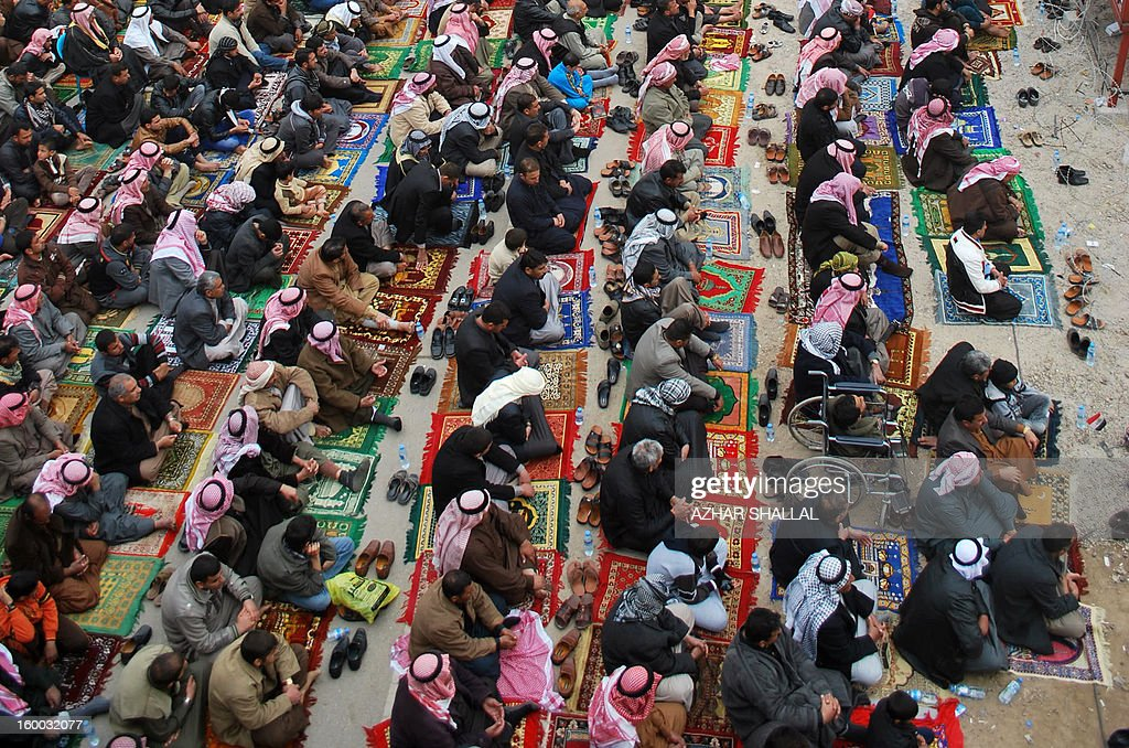 Anti-government protesters perform the weekly Friday prayer in the western Iraqi city of Ramadi on January 25, 2013. The longest-running of the protests, in Ramadi, has cut off a key trade route linking Baghdad to Jordan and Syria for a month.