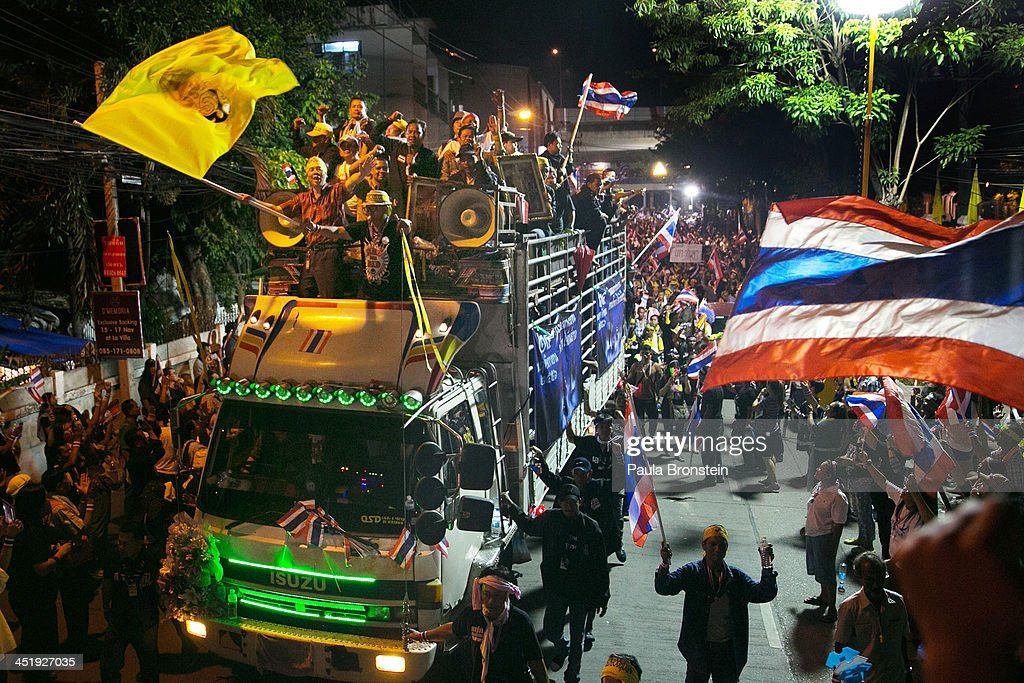 Anti-government protesters ride in a truck as they occupy the Finance ministry and the Foreign Ministry in a bid to oust the current government of Yingluck Shinawatra November 25, 2013 in Bangkok, Thailand. Security guards and riot police deployed failed to resist protesters who quickly took control of the building without violence as the protests continue.
