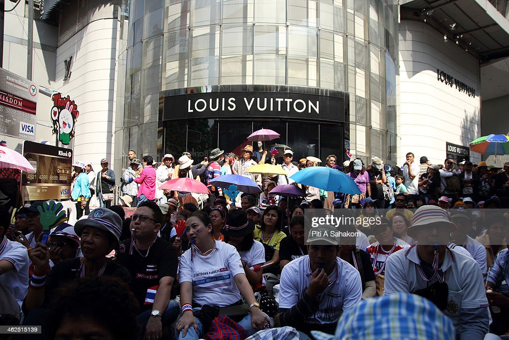 Anti-government protesters sit near a Louis Vuitton shop during a rally at Rajprasong intersection in Bangkok. Major intersections were blocked in Thailand's capital as protesters began a 'Bangkok shutdown' campaign to force out the government of caretaker Prime Minister Yingluck Shinawatra. Thai anti-government protesters said they would set up protest camps at seven main intersections in Bangkok in their bid to paralyse the capital. Protest leader Suthep Thaugsuban said 'We will do it all days and we will do it everyday until we win''.