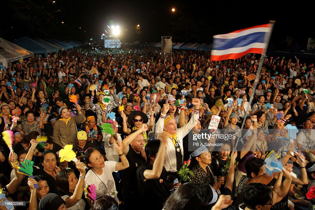 Anti-government protesters wave a Thai flag and chant slogans during a rally against the amnesty bill at at Samsen railway station in Bangkok. More than ten thousand Anti-government protesters gathered in a massive rally to oppose the amnesty bill being debated in the second reading in the Parliament. Opponents of the political amnesty bill fear it will whitewash past abuses by politicians and allow ousted former prime minister Thaksin Shinawatra to return from exile..