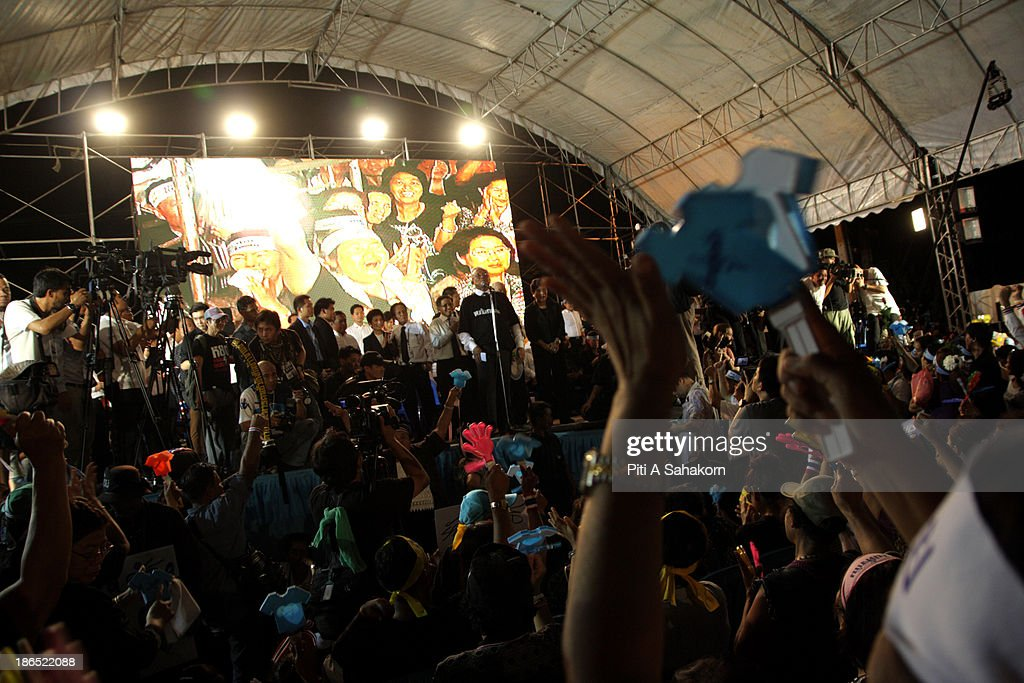 Anti-government protesters wave clapping tools and chant slogans during a rally against the amnesty bill at at Samsen railway station in Bangkok. More than ten thousand Anti-government protesters gathered in a massive rally to oppose the amnesty bill being debated in the second reading in the Parliament. Opponents of the political amnesty bill fear it will whitewash past abuses by politicians and allow ousted former prime minister Thaksin Shinawatra to return from exile..
