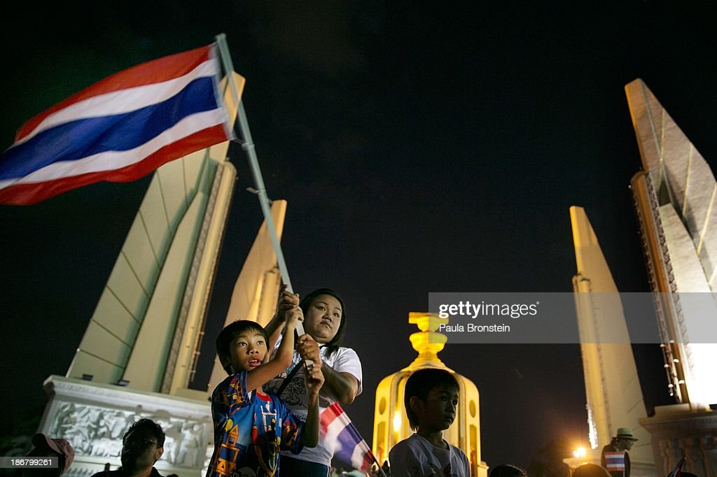 Anti-government protesters waves Thai flags during a rally against a controversial Amnesty bill that passed in Parliament last week on November 4, 2013 in Bangkok, Thailand. Thousands attended various protests around the capitol city organised by the opposition Democrat Party. If the law goes into effect it whitewash all crimes for which the billionaire former leader Thaksin Shinawatra was convicted, setting the stage for him to return to Thailand.