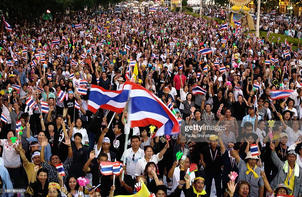 Anti-government protesters waves Thai flags during a rally against a controversial Amnesty bill that passed in Parliament last week in Bangkok, Thailand on November 4, 2013. Thousands attended various protests around the capitol city organised by the opposition Democrat Party. If the law goes into effect protestors fear it could whitewash all crimes for which the billionaire former leader Thaksin Shinawatra was convicted, setting the stage for him to return to Thailand.