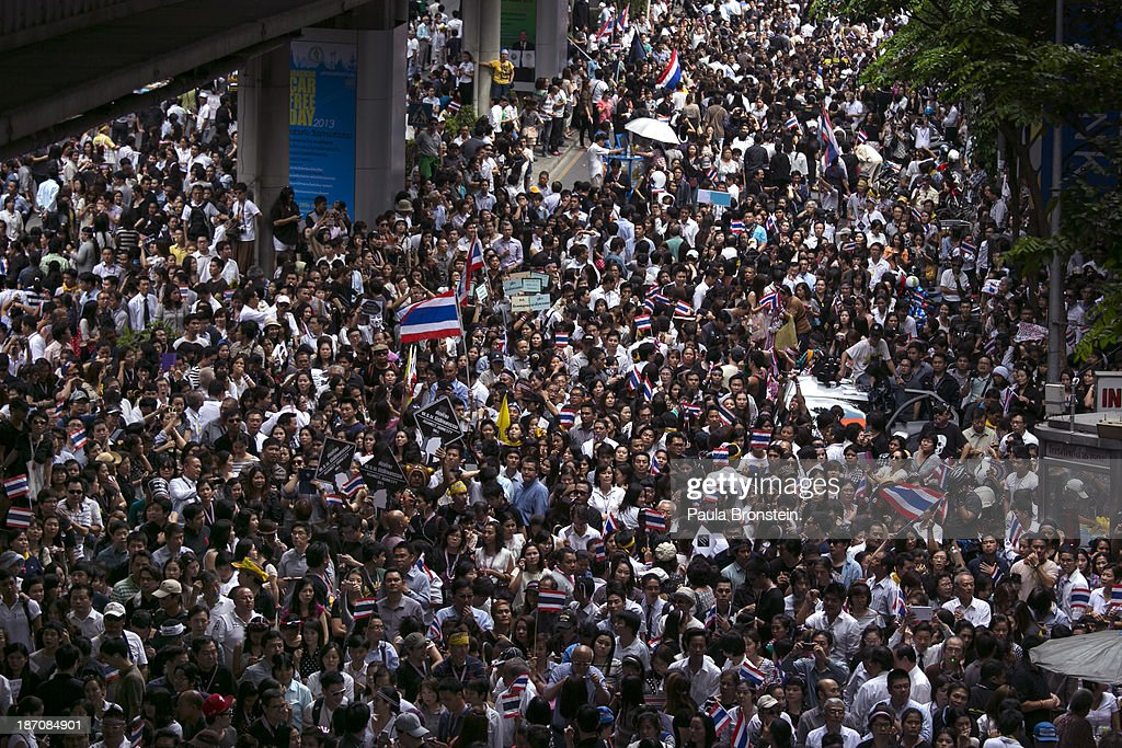 Anti-government protestors attend a downtown lunch time rally against a controversial Amnesty bill that passed in Parliament recently in Bangkok, Thailand on November 6, 2013. Thousands attended various protests around the capitol city organized by the opposition Democrat Party. If the law goes into effect it will whitewash all crimes against the billionaire, former leader Thaksin Shinawatra setting the stage for him to return to Thailand.