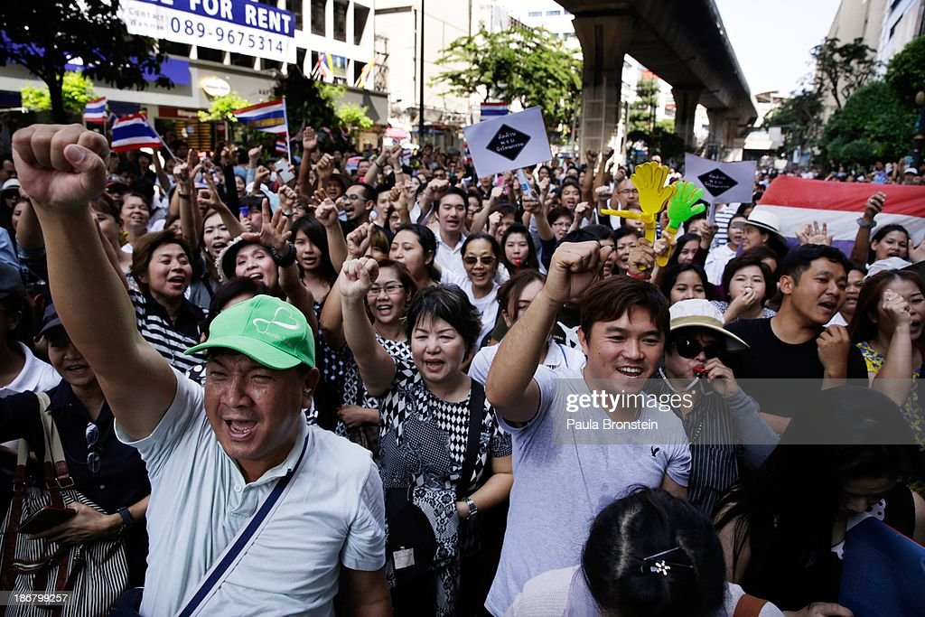 Anti-government protestors cheer during rally against a controversial Amnesty bill that passed in Parliament last week on November 4, 2013 in Bangkok, Thailand. Thousands attended various protests around the capitol city organised by the opposition Democrat Party. If the law goes into effect protestors fear it could whitewash all crimes for which the billionaire former leader Thaksin Shinawatra was convicted, setting the stage for him to return to Thailand.