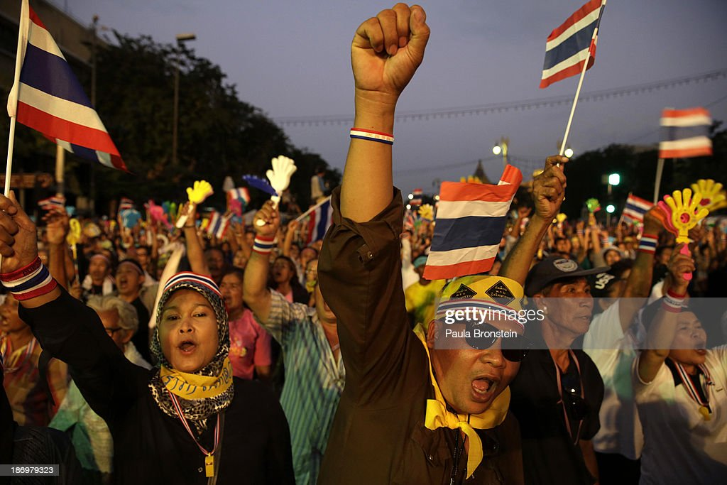 Anti-government protestors cheer during rally against a controversial amnesty bill that passed in Parliament last week on November 5, 2013 in Bangkok, Thailand. Thousands attended various protests around the capitol city organized by the opposition Democrat Party. If the law goes into effect it will whitewash all crimes against the billionaire, former leader Thaksin Shinawatra setting the stage for him to return to Thailand.