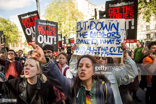 Antigovernment protestors gather outside Downing Street during a march down Whitehall on May 9 2015 in London England After the United Kingdom went...