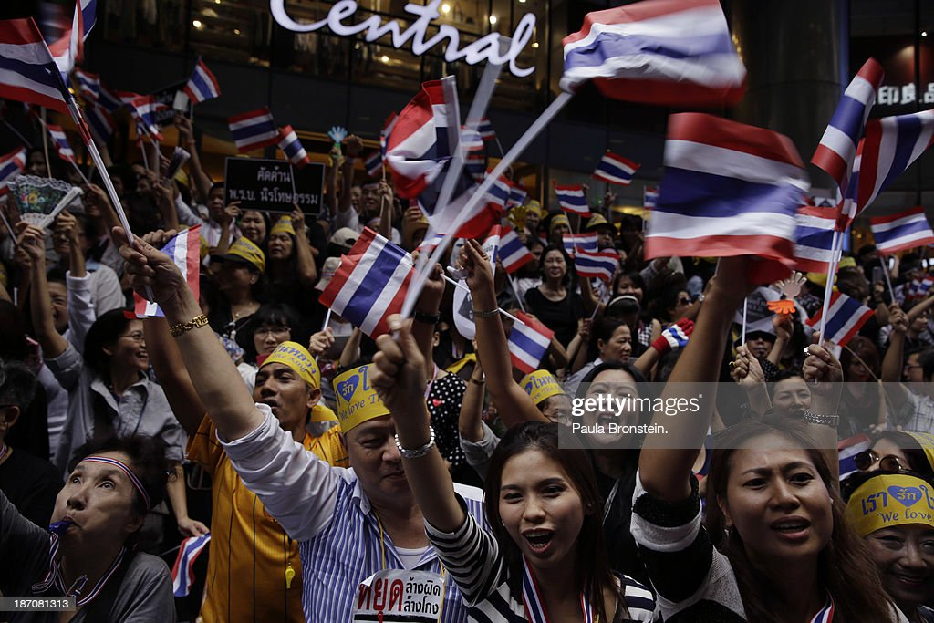 Anti-government protestors wave a Thai flags during a downtown lunch time rally against a controversial Amnesty bill that passed in Parliament recently in Bangkok, Thailand on November 6, 2013. Thousands attended various protests around the capitol city organized by the opposition Democrat Party. If the law goes into effect it will whitewash all crimes against the billionaire, former leader Thaksin Shinawatra setting the stage for him to return to Thailand.