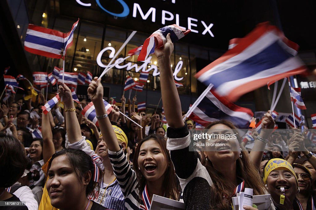 Anti-government protestors wave Thai flags during a downtown lunch time rally against a controversial Amnesty bill that passed in Parliament recently in Bangkok, Thailand on November 6, 2013. Thousands attended various protests around the capitol city organized by the opposition Democrat Party. If the law goes into effect it will whitewash all crimes against the billionaire, former leader Thaksin Shinawatra setting the stage for him to return to Thailand.