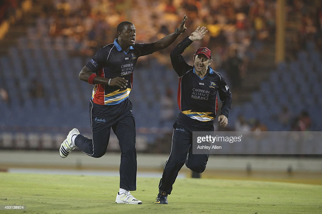 Antigua Hawksbills players <a gi-track='captionPersonalityLinkClicked' href=/galleries/search?phrase=David+Hussey&family=editorial&specificpeople=193810 ng-click='$event.stopPropagation()'>David Hussey</a> (R) and Carlos Brathwait (L) celebrate a wicket during a match between St. Lucia Zouks and Antigua Hawksbills as part of week 4 of the Limacol Caribbean Premier League 2014 at Beausejour Stadium on August 03, 2014 in Castries, St. Lucia.