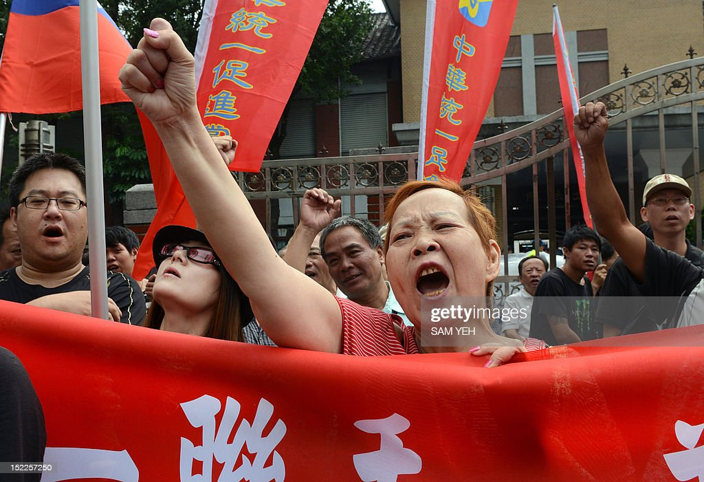 Anti-Japan activists chant slogans in front of the parliament building in Taipei to demand the Taiwan government to cooperate with China against Japan over a group of disputed islands, known as the Diaoyu islands in Chinese or the Senkaku islands in Japanese, on September 18, 2012. A group of Taiwanese fishermen are planning to sail this week to the disputed archipelago in the East China Sea at the centre of a territorial row among Taiwan, China and Japan, a politician said. AFP PHOTO / Sam Yeh