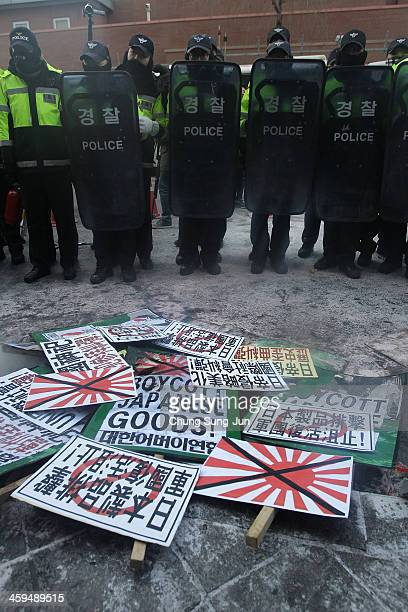 AntiJapan placards are seen during a antiJapan rally in front of the Japanese embassy on December 27 2013 in Seoul South Korea On December 26...