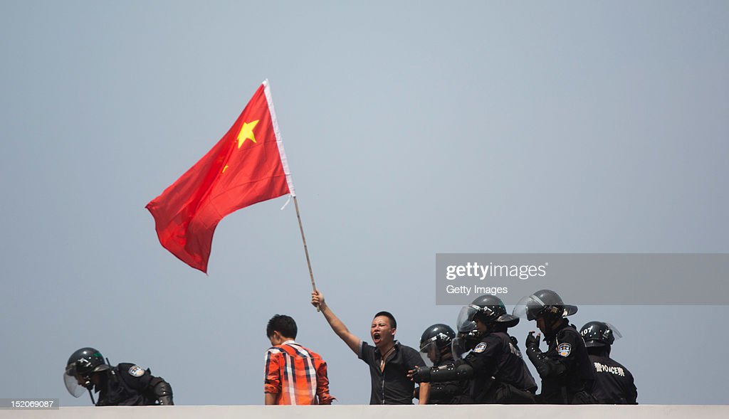 AntiJapanese protesters are confronted by police as they demonstrate over the disputed Diaoyu Islands on September 16 2012 in Shenzhen China Protests...