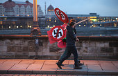 AntineoNazi activists carry signs showing smarked through swastikas before the creation of a human chain in the city center as a statement against...