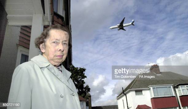 Antinoise campaigner Miss Nina Bevan outside her home in Hounslow with a plane on the Heathrow airport flightpath Campaigners were celebrating a key...