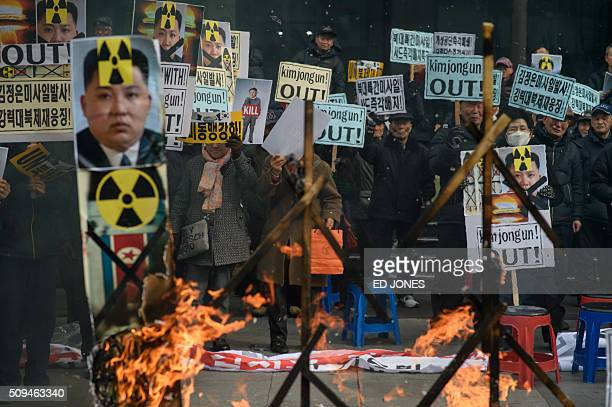 AntiNorth Korean activists hold banners and shout slogans as they protest the latest nuclear test and rocket launch by Pyongyang in Seoul on February...