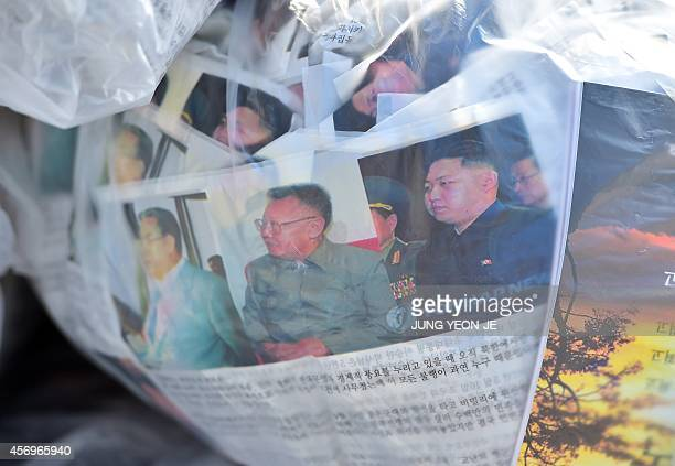 AntiNorth Korean leaflets showing pictures of Kim JongIl and Kim JongUn are seen before South Korean activists release balloons carrying the leaflets...