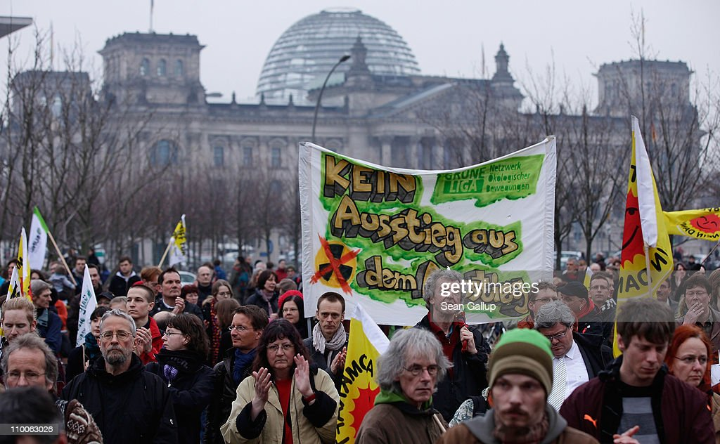 Anti-nuclear activists demonstrate near the Reichstag on March 14, 2011 in Berlin, Germany. Thousands of anti-nuclear demonstrators, in reaction to the dramatic situation at the Fukushima nuclear facility in Japan, gathered in a coordinated effort in cities across Germany to protest against the government-granted extension of the operational lives of Germany's older nuclear power plants. The debate over the safety of nuclear energy has been reignited worldwide following the earthquake and tsunami in Japan that severely damaged the Fukushima plant and where workers are desperately seeking to prevent a nuclear meltdown.