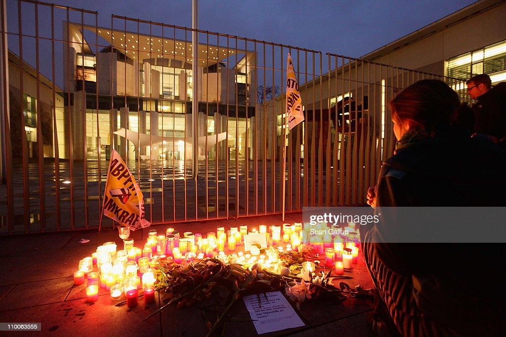 Anti-nuclear activists light candles during a demonstration in front of the Chancellery on March 14, 2011 in Berlin, Germany. Thousands of anti-nuclear demonstrators, in reaction to the dramatic situation at the Fukushima nuclear facility in Japan, gathered in a coordinated effort in cities across Germany to protest against the government-granted extension of the operational lives of Germany's older nuclear power plants. The debate over the safety of nuclear energy has been reignited worldwide following the earthquake and tsunami in Japan that severely damaged the Fukushima plant and where workers are desperately seeking to prevent a nuclear meltdown.