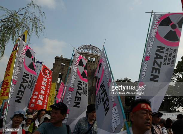 Antinuclear activists march front of a Atomic Bomb Dome at the Hiroshima Peace Memorial Park on the day of the 68th anniversary of the atomic bombing...