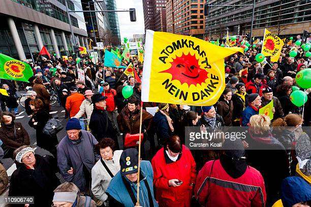Antinuclear activists march to demand Germany disband nuclear energy on March 26 2011 in Berlin Germany The antinuclear debate in Germany has been...