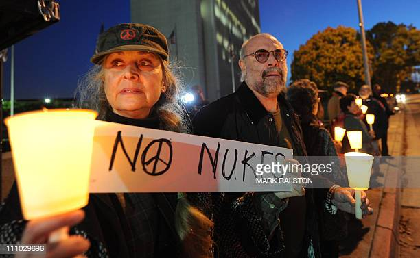 Antinuclear demonstrators hold a candlelight vigil to protest against nuclear power outside the Federal Building in Los Angeles on March 28 2011...