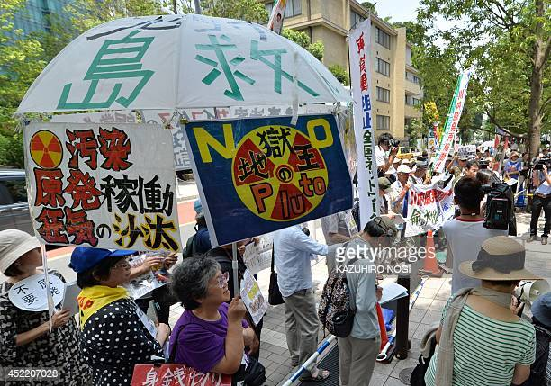 Antinuclear demonstrators stage a rally in Tokyo on July 16 2014 Japan's nuclear regulator said on July 16 that two atomic reactors were safe enough...