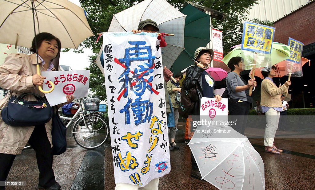 Anti-nuclear protesters demonstrate at the Kyushu Electoric Powe Co shareholders meeting site on June 26, 2013 in Fukuoka, Japan. Japan's all nine electric power companies hold shareholders meeting, denied 72 shareholders proposals of nuclear-free power generation, took clear stance of restarts of nuclear power plants in Japan.