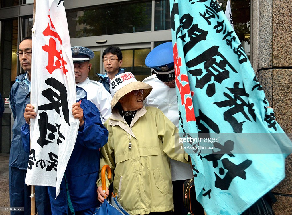 Anti-nuclear protesters demonstrate outside the Chugoku Electric Power Co shareholders meeting site on June 26, 2013 in Hiroshima, Japan. Japan's all nine electric power companies hold shareholders meeting, denied 72 shareholders proposals of nuclear-free power generation, took clear stance of restarts of nuclear power plants in Japan.