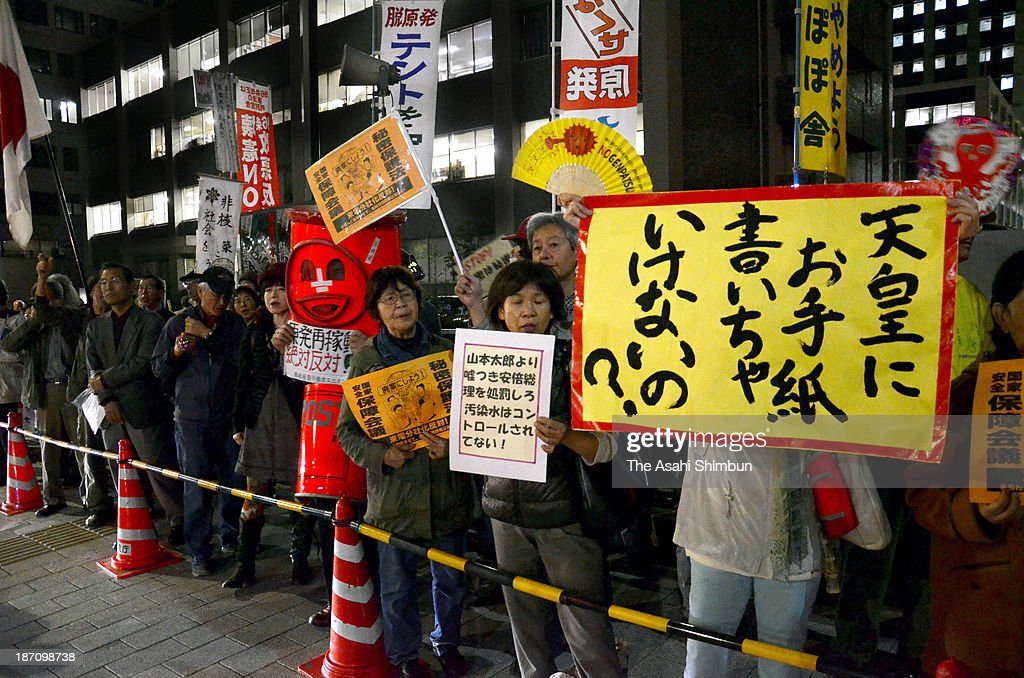 Anti-nuclear protesters hold a banner saying 'Why don't we write a letter to Emperor?' during a rally in front of the Prime Minister Shinzo Abe's official residence on November 1, 2013 in Tokyo, Japan. The rally is the first one after upper house lawmaker Taro Yamamoto handed a letter concerning the nuclear crisis and current situation of Fukushima during the Imperial Garden Party.