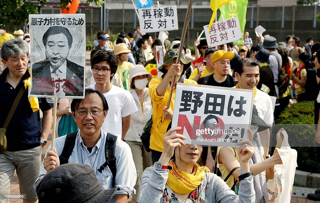 Anti-nuclear protesters holding 'No to Noda' placard march on during the rally against the restart of the Oi Nuclear Power Plant in Japanese Prime Minister Yoshihiko Noda's hometown on June 24, 2012 in Funabashi, Chiba, Japan.
