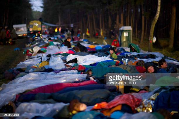 Antinuclear protesters in sleeping bags lay on a street near Gorleben northern Germany on November 28 along the route of the socalled Castor...