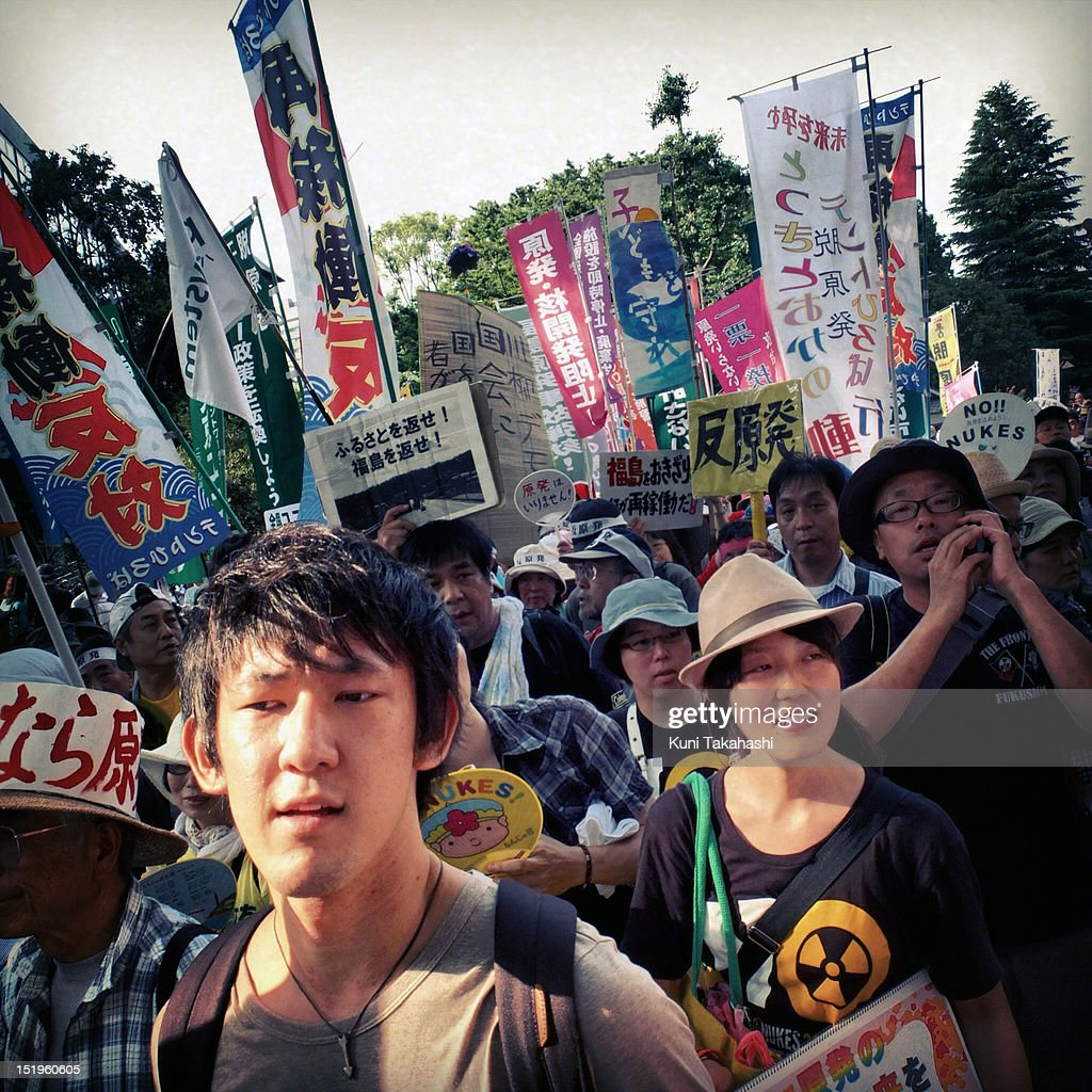 Anti-nuclear protesters march during a mass demonstration on July 29, 2012 in Tokyo, Japan. Police have imposed tight controls on the weekly protest against restarting nuclear power plants. All 54 of Japan's nuclear plants had been offline for months, in the wake of the disaster at the Fukushima Daiichi nuclear plant. Protesters wanted the government to reconsider its energy policy but the government decided to restart the Ohi nuclear plant anyway.