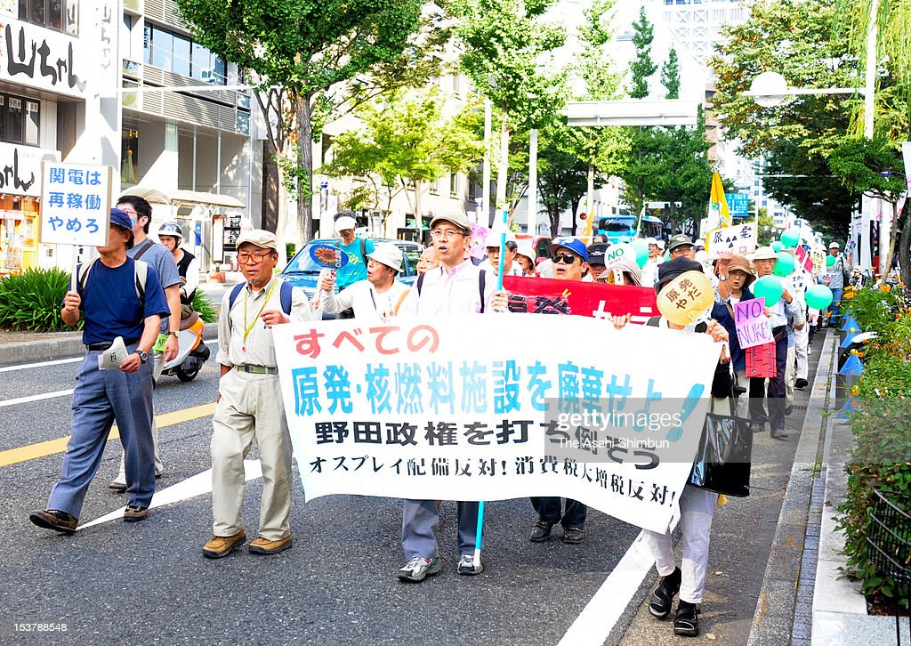 Anti-nuclear protesters march on central Nagoya on October 7, 2012 in Nagoya, Aichi, Japan. The rally, planned by people who participate in the protest every Friday in front of Kansai Electric Power Co., Tokai Branch, attracts 3,000 people.