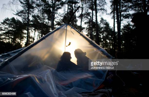 Antinuclear protesters sit in a tent on the street near Gorleben northern Germany on November 28 along the route of the socalled Castor transport The...