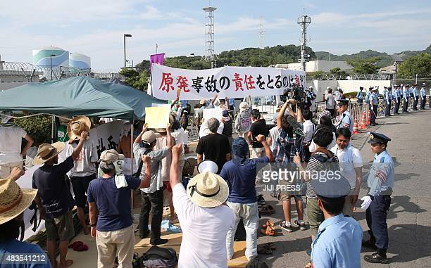 Antinuclear protesters stage a rally against the restarting of the nuclear reactor in front of the Kyushu Electric Power Sendai nuclear power plant...