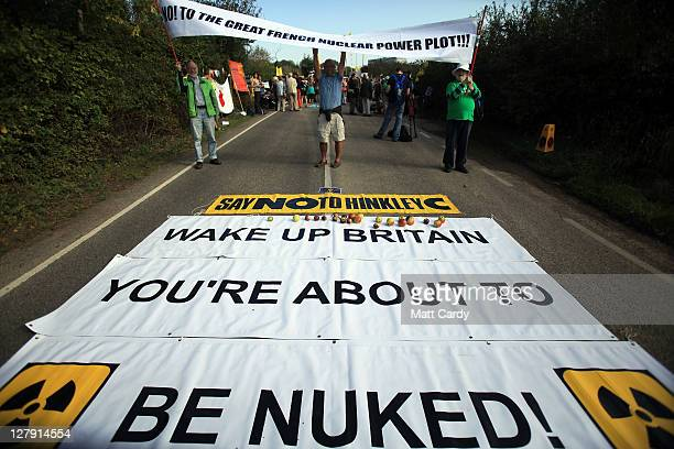 Antinuclear protestors gather at the gates of Hinkley Point nuclear power station on October 3 2011 in Bridgwater England Antinuclear protestors have...